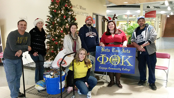 PTK members Peter Denton, Laurie Goodall, Sara Hogan, Jennifer James (president, CCC student), Shauna Nesbitt, PTK advisor and parent