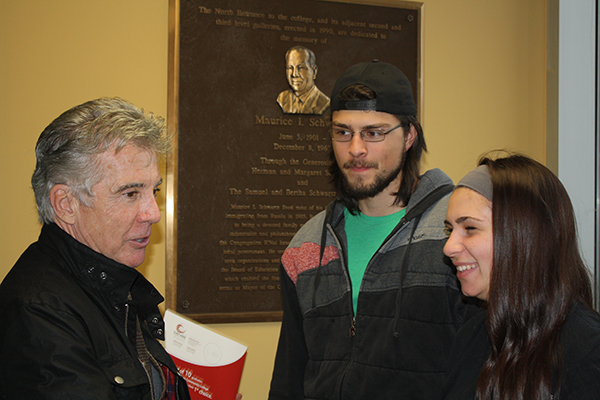 Johh Walsh talking with students