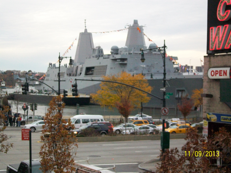 Navy ship docked next to the USS Intrepid